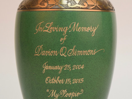 AN EXAMPLE OF URN EARNING:  HOW TO HAND-ENGRAVE THE METAL CONTAINER.