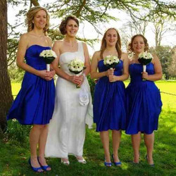 bride and blue dress bridesmaids wearing bridal accessories