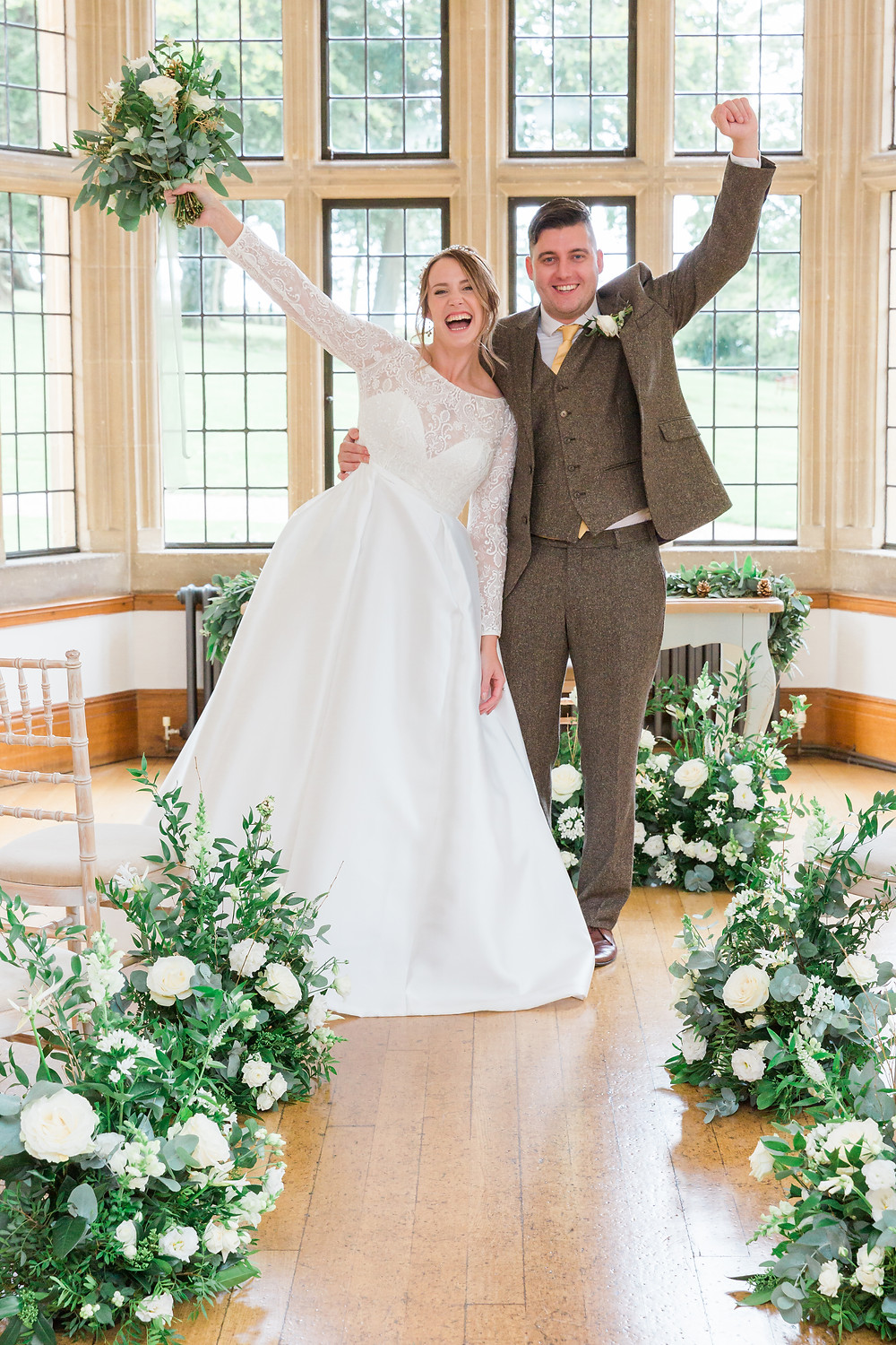 wedding couple at Coombe Lodge wearing Bridal Accessories from Abigail Grace and a dress from Sassi Holford