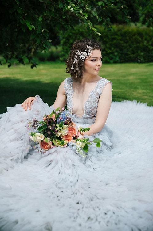 bride sat down blue dress wearing bridal hair vine