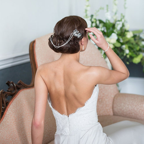 back view bride pink chair white  dress flowers wearing vintage wedding hair chain