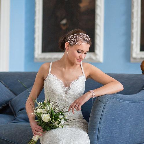bride blue chair clue walls flowers white dress pink bridal headdress