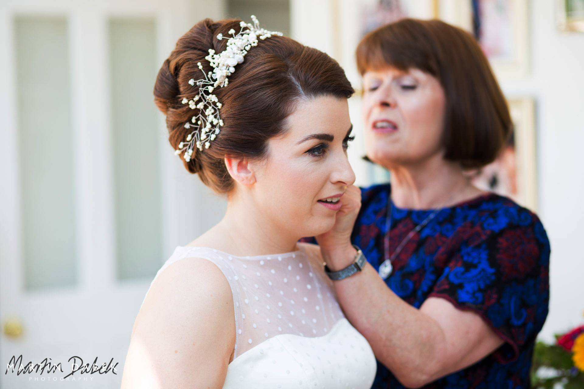 bride and mother wearing bridal hair comb