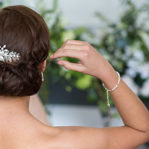 bride arm and head with crystal and pearl bridal bracelet