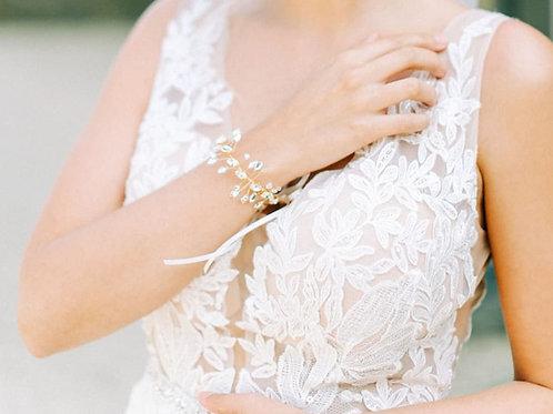 close up of gold sparkly bridal bracelet
