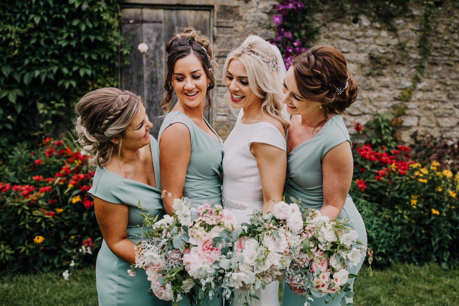 bridesmaids in mint dress with bride wearing bridal accessories