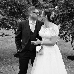 wedding couple in black and white wearing venice bridal hair vine