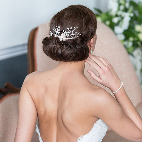 back view of bride brunette hair with pearl floral wedding hair comb