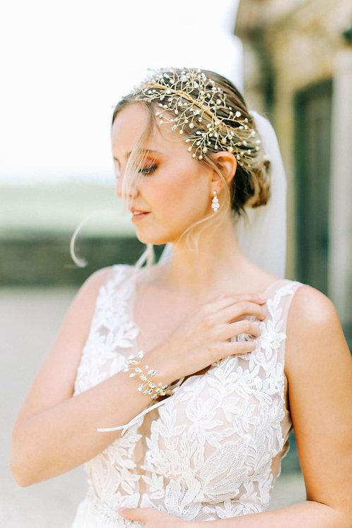 bride white dress gold bridal headdress and sparkly gold bridal bracelet