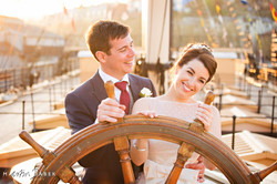 bride and groom on boat wearing bridal comb