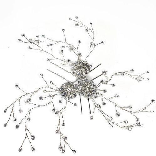 white back ground three crystal hair pins