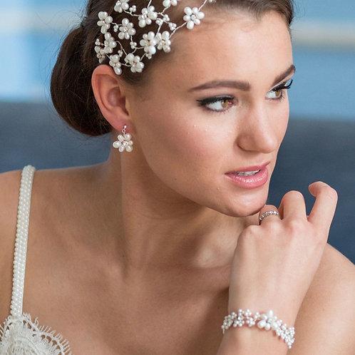 bride side view bridal pearl headdress with peal floral wedding earrings