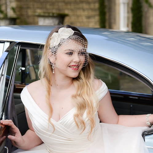 bride blue car white dress bridal headpiece and birdcage veil