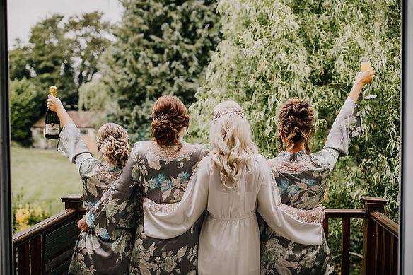 4 bridesmaids wearing bridal hair pins with bride celebrating