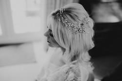 close up of bride wearing bridal crystal hair vine