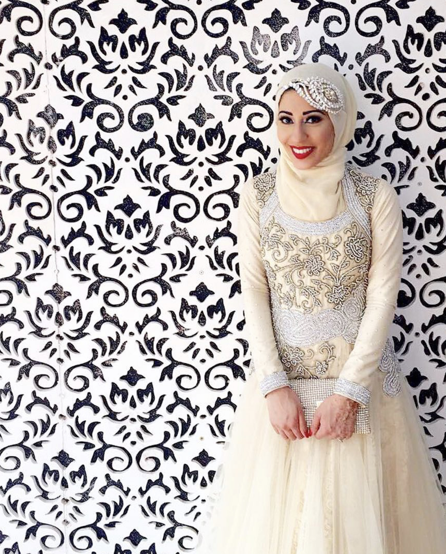 bride with black and white wallpaper wearing crystal bridal headdress