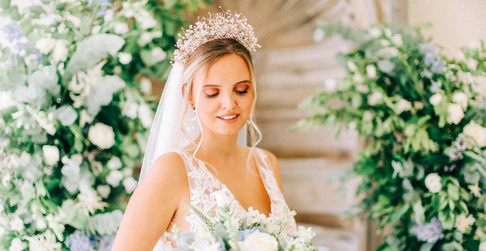 bride with rose gold tiara with lots of flowers
