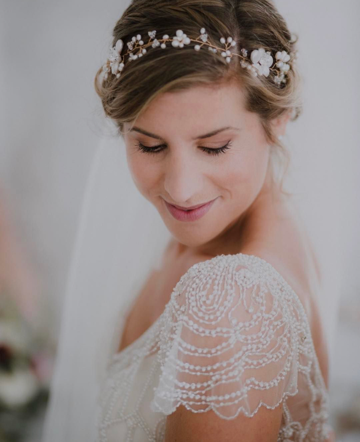 close up of bride wearing pearl bridal hair garland