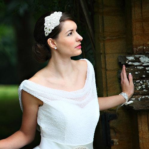 bride in gate brunette hair white dress diamond shaped wedding headdress