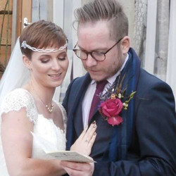 wedding couple reading a book with bohemian bridal hair chain