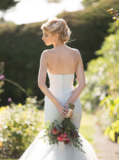 bride in garden white dress wearing mother of pearl wedding hair vine