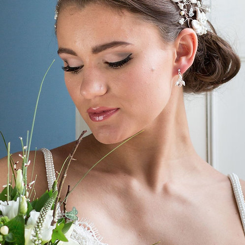 bride with flowers blue wall crystal diamante wedding earrings