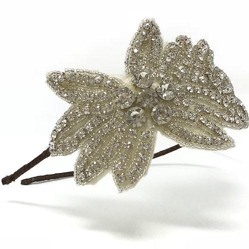 white background crystal embellished bridal headband on brown ribbon