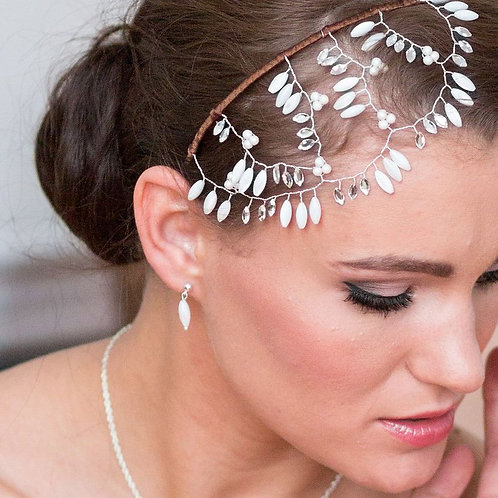 close up bride face mother of pearl bridal earrings