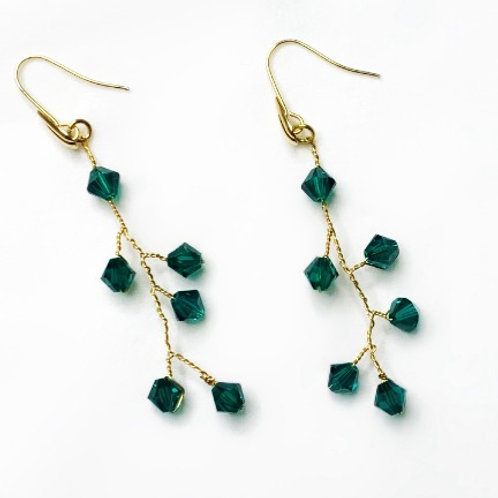 white background green and gold bridal earrings