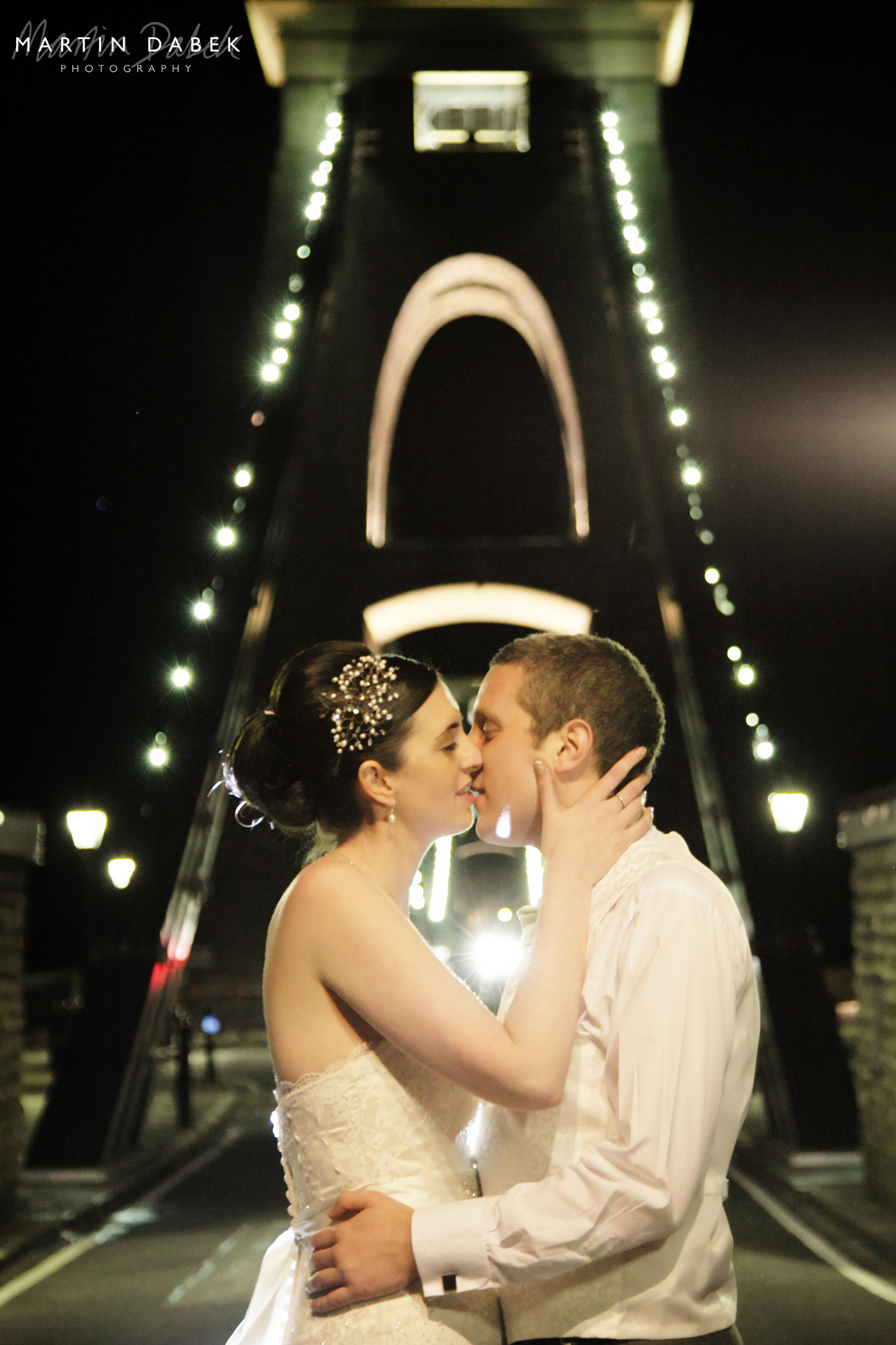 wedding couple in Bristol on bridge with wedding headpiece e