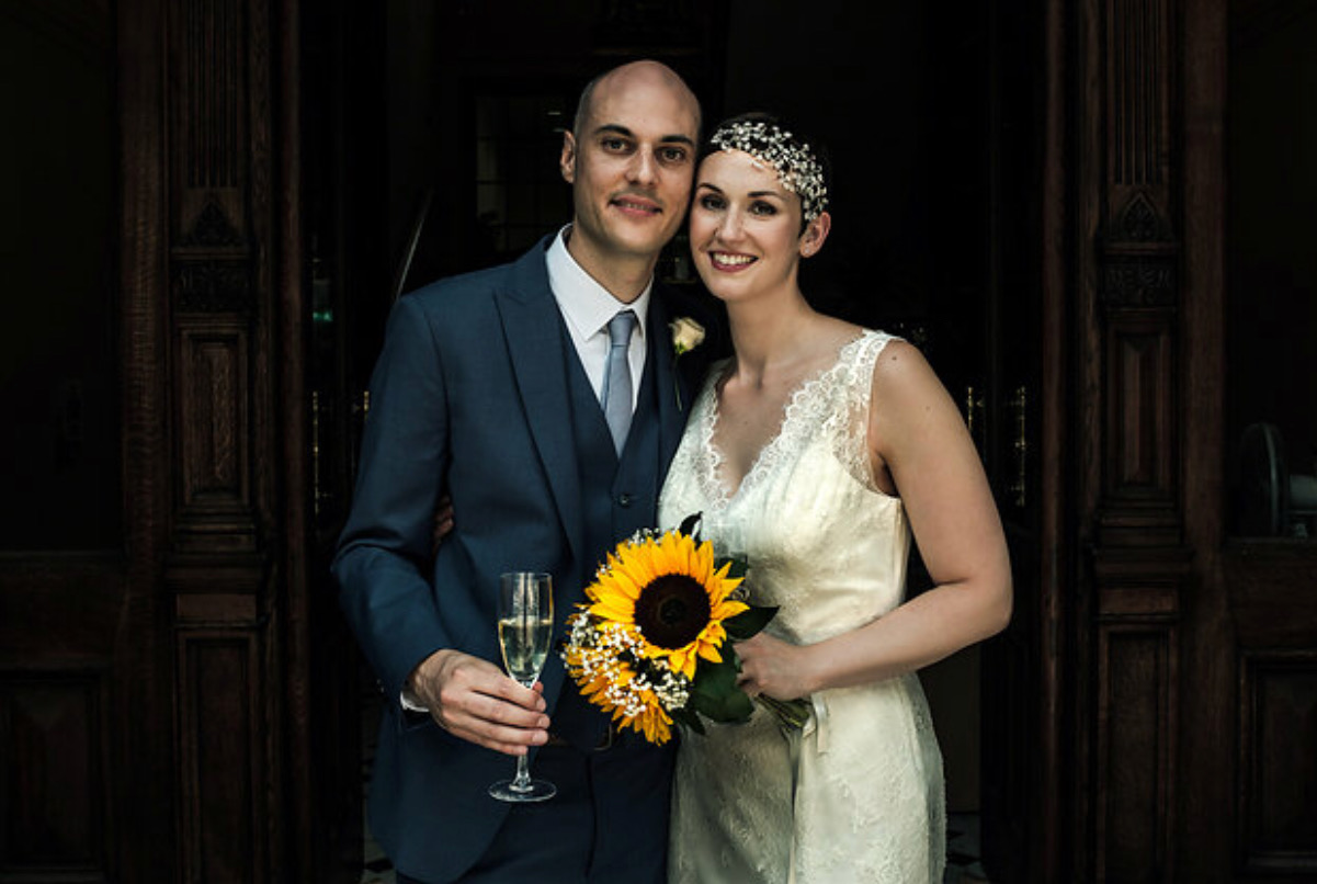 wedding coupe with sunflower wearing pearl wedding headdress