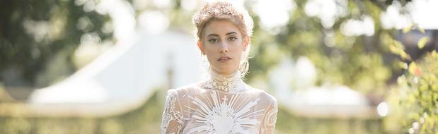 bride wearing white dress wearing gold bridal tiara