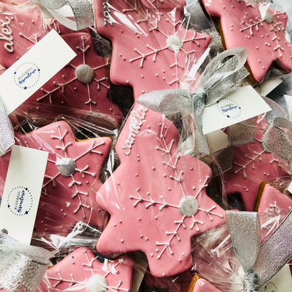 Pretty personalised pink Christmas tree biscuits