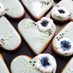 Pale green iced hearts with white flower biscuits