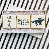 These edible hand iced invites by post were commissioned by one of our favourite corporate clients