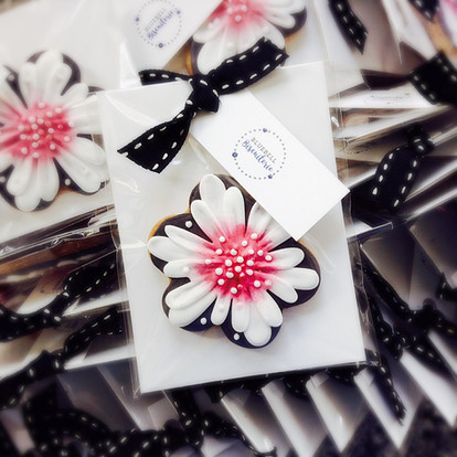 Pretty black, white and pink flower iced biscuit favours