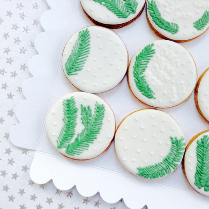 Pretty round biscuits with fir tree design