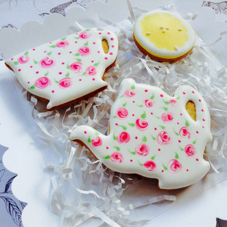 Teapot, saucer and lemon iced biscuits