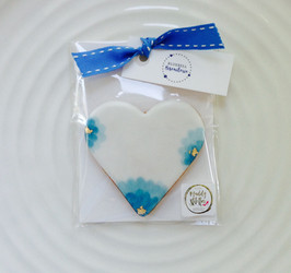 White heart iced biscuit favour with blue and a touch of gold leaf