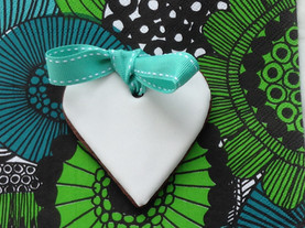 White heart iced biscuit with green ribbon