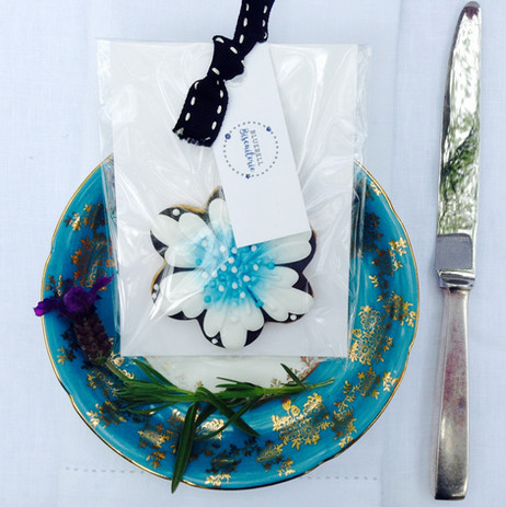 Pretty blue flower iced biscuit on plate