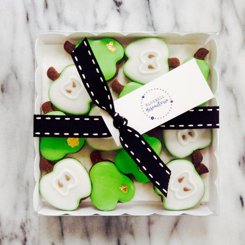 Mini apple and pear iced biscuits with a touch of gold leaf