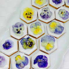 Iced hexagon biscuits with crystallised pansies