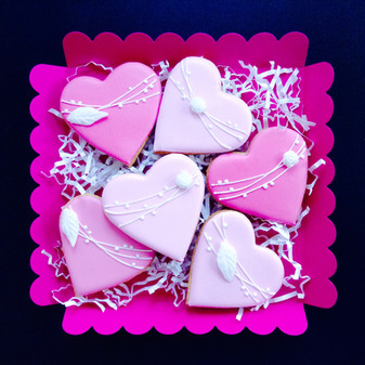 Pink heart iced biscuits with rose garland