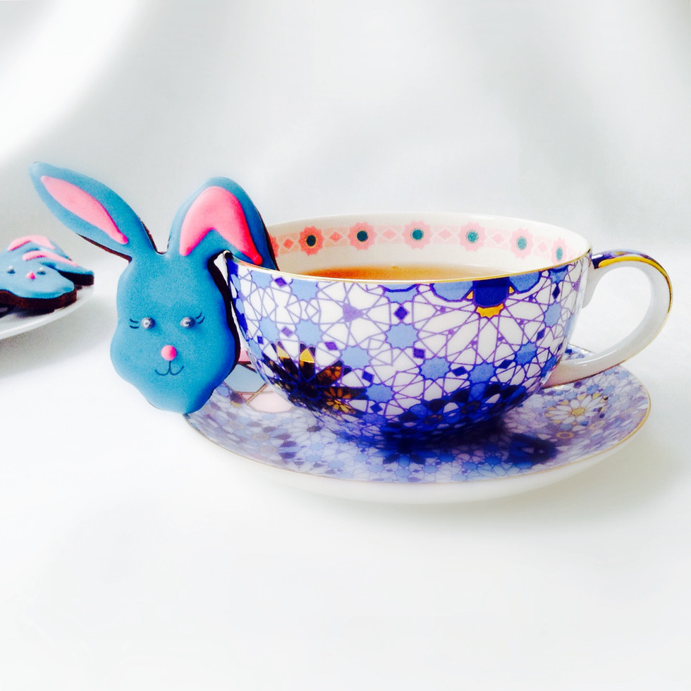 The cute bunny cup slider iced biscuits make a lovely Easter gift