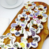 Pretty lemon biscuits with crystallised flowers