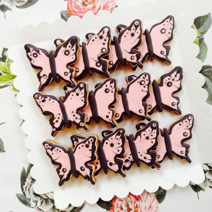 A dozen butterfly iced biscuits