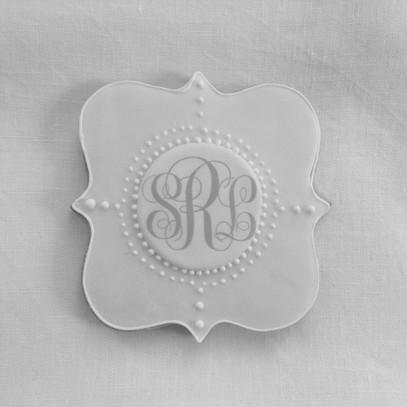 Plaque with monogram biscuits