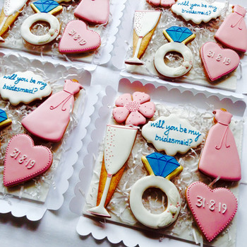 'Will you be my bridemaid?' themed iced biscuits