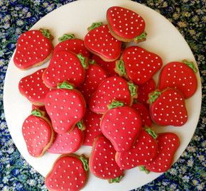 A plate of iced strawberry biscuits